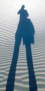 Picture of photographer's shadow across Eureka Dunes, Death Valley, CA.